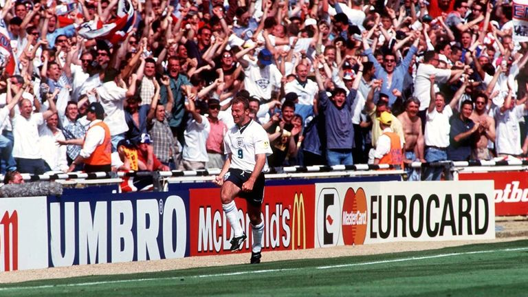 Shearer celebrates in front of the England fans at Wembley