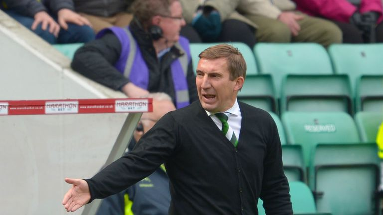 Hibernian manager Alan Stubbs directs his players against Queen of the South