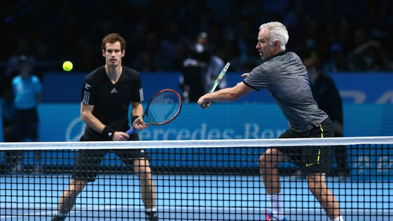 John McEnroe (right) says he would be interested in working with Murray