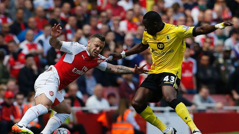 Wilshere (left) vies with Aly Cissokho at the Emirates Stadium