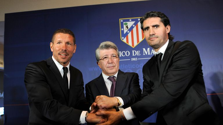 Atletico Madrid's new coach Diego Simeone pose with the club's president Enrique Cerezo and sports manager Jose Luis Perez Caminero in December 2011