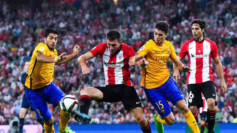 Laporte battles for the ball with Barcelona's Luis Suarez and Marc Bartra