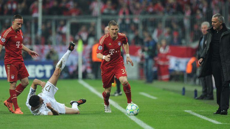 Bayern Munich's midfielder Bastian Schweinsteiger (with ball) and Jose Mourinho (right)
