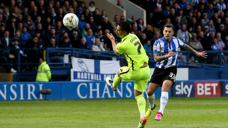 Sheffield Wednesday's Ross Wallace scores the opening goal against Brighton