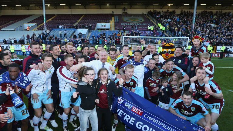 Burnley players celebrate promotion to the Premier League for the second time under Dyche