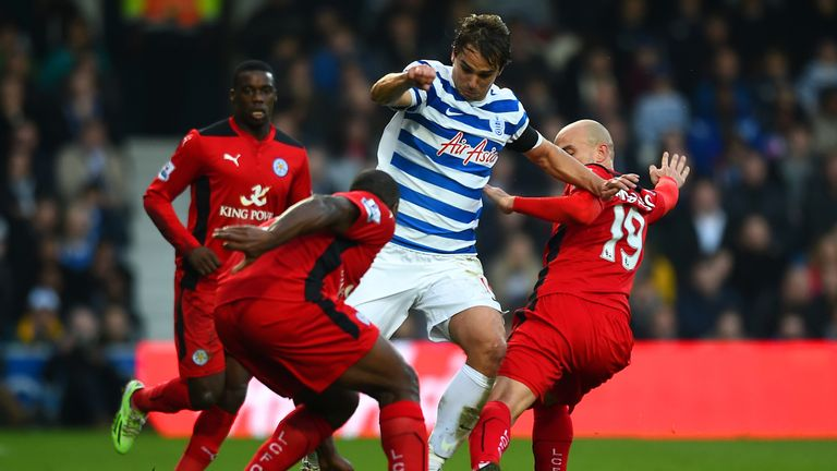 Former QPR midfielder Niko Kranjcar (centre) battles for the ball with Leicester's Esteban Cambiasso (right) and Wes Morgan (left)