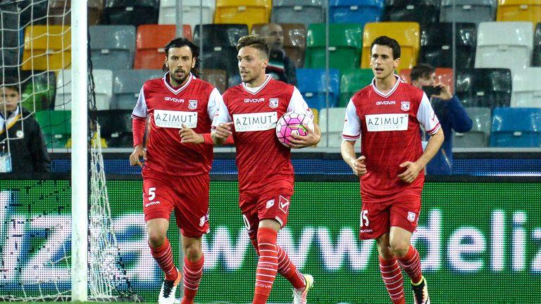 Simone Verdi (centre) of Carpi celebrates after scoring