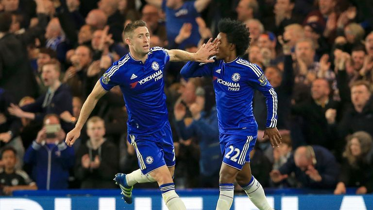 Cahill (left) celebrates with team-mate Willian