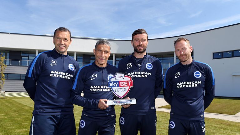 Chris Hughton celebrates his Sky Bet Championship Manager of the Month award with his staff