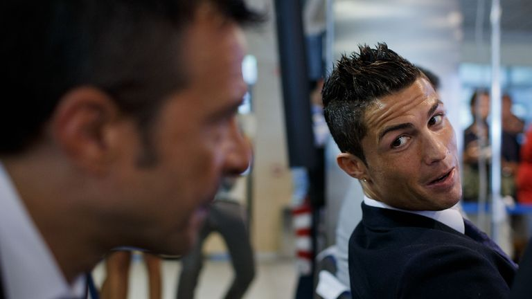 MADRID, SPAIN - SEPTEMBER 15:  Crsitiano Ronaldo (R) speaks with his agent Jorge Mendes (R) after his signing contract renewal For Real Madrid at Estadio S
