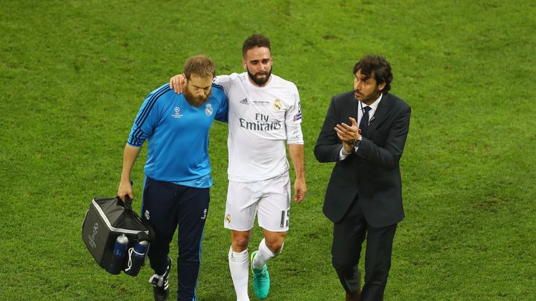 MILAN, ITALY - MAY 28:  Dani Carvajal of Real Madrid is is lead of the pitch as he substituted after getting injured during the UEFA Champions League Final