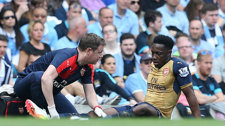 Arsenal's Danny Welbeck lays injured during the Barclays Premier League match at the Etihad Stadium, Manchester.