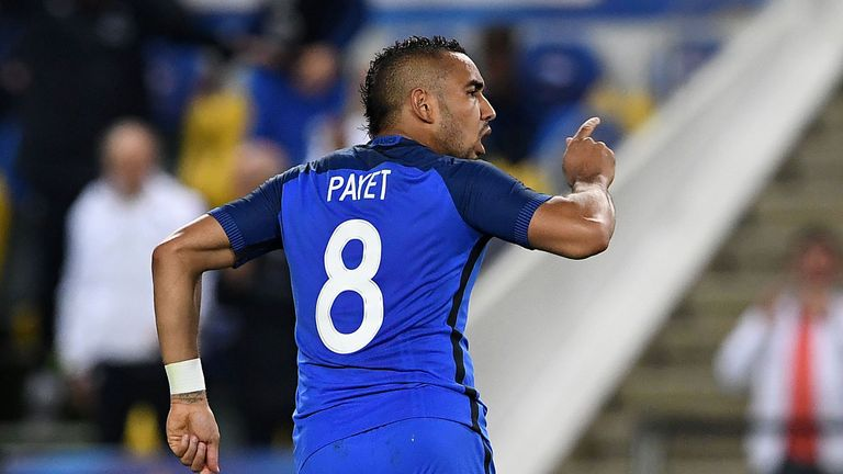 France forward Dimitri Payet celebrates after scoring the winner against Cameroon