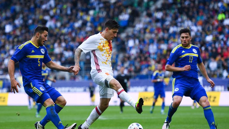 Hector Bellerin (centre) of Spain competes for the ball with Sead Kolasinac (L) and Ervin Zukanovic of Bosnia-Herzegovina