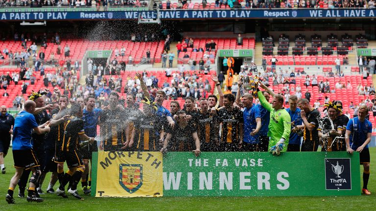 Morpeth Town celebrate with the trophy after winning the FA Vase final