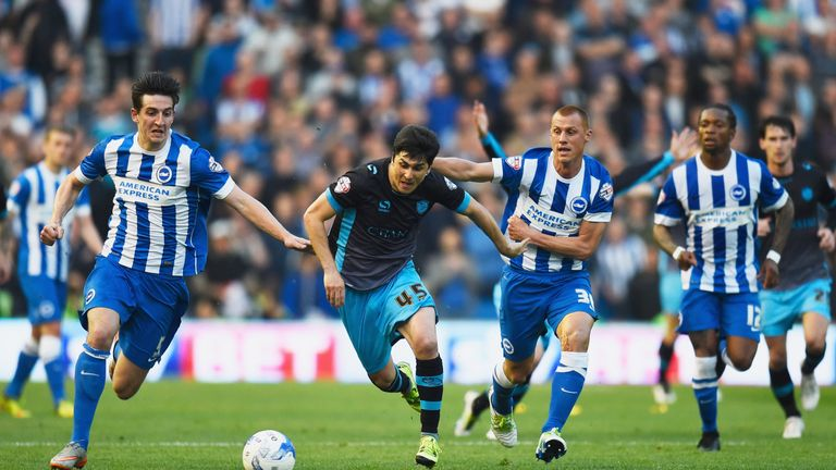 Fernando Forestieri is chased by Lewis Dunk and Steve Sidwell