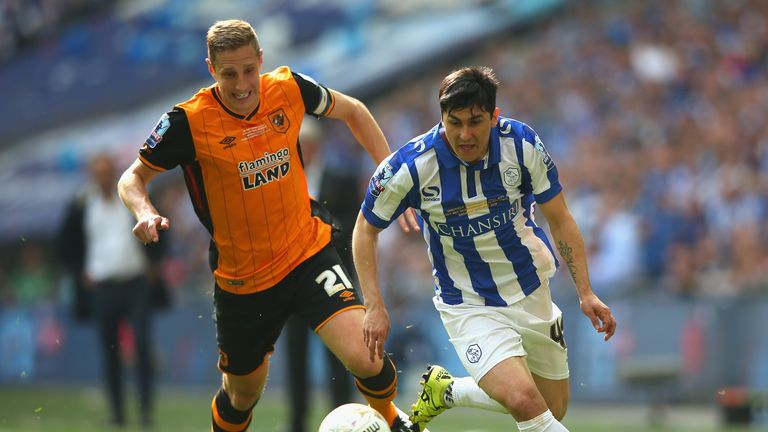 Fernando Forestieri of Sheffield Wednesday and Michael Dawson of Hull City compete for the ball during Sky Bet Championship play-off final