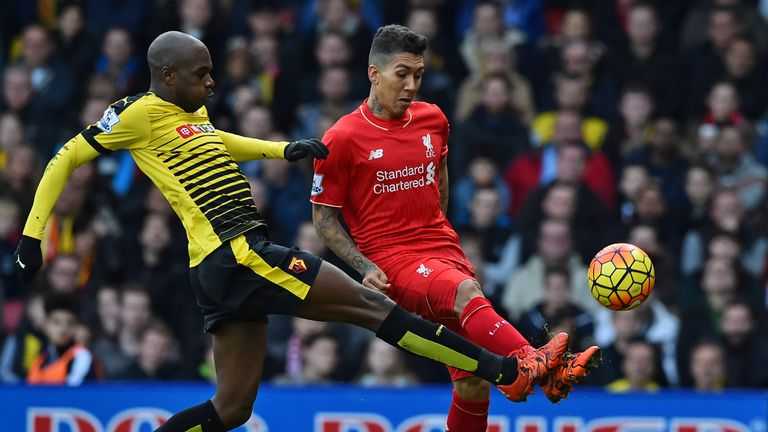 Liverpool's Brazilian midfielder Roberto Firmino (R) has an unsuccessful attempt on goal as Watford's Cameroonian