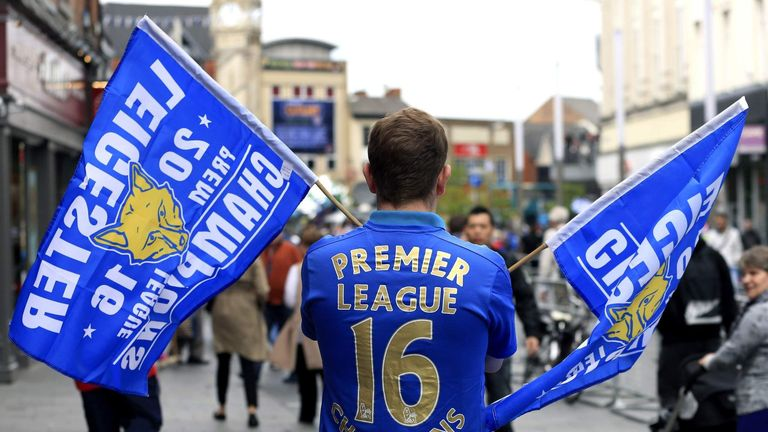 A Leicester City fan shows support for his side