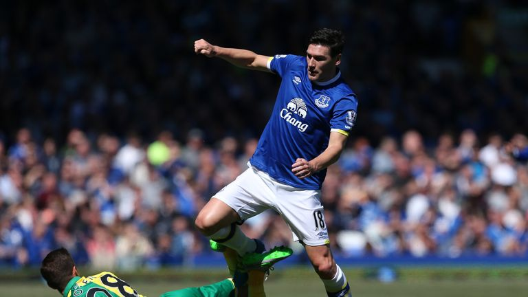 Gareth Barry jumps over the challenge of Gary O'Neil