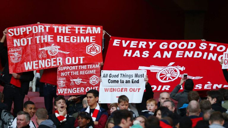 Arsenal supporters stage a protest against Arsene Wenger