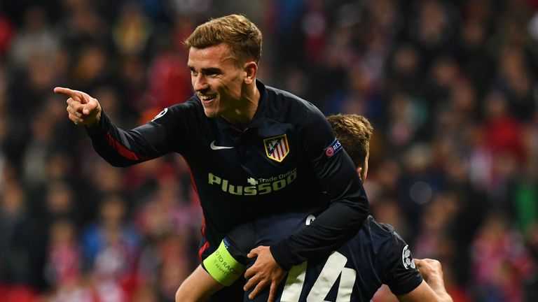 Antoine Griezmann celebrates scoring with his team-mates during the UEFA Champions League semi-final