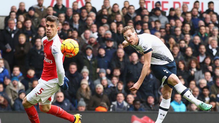 Harry Kane of Tottenham Hotspur shoots past Gabriel of Arsenal