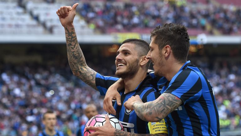 Mauro Icardi (L) of FC Internazionale Milano celebrates after scoring the opening goal with team mate Stevan Jovetic during the Ser