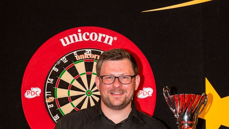 James Wade displays the trophy after winning the European Darts Matchplay title