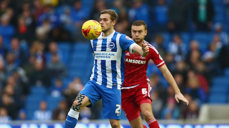 James Wilson of Brighton and Hove Albion shields the ball from Ben Gibson of Middlesbrough