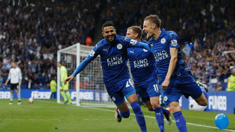 Jamie Vardy (R) celebrates with Riyad Mahrez (L)