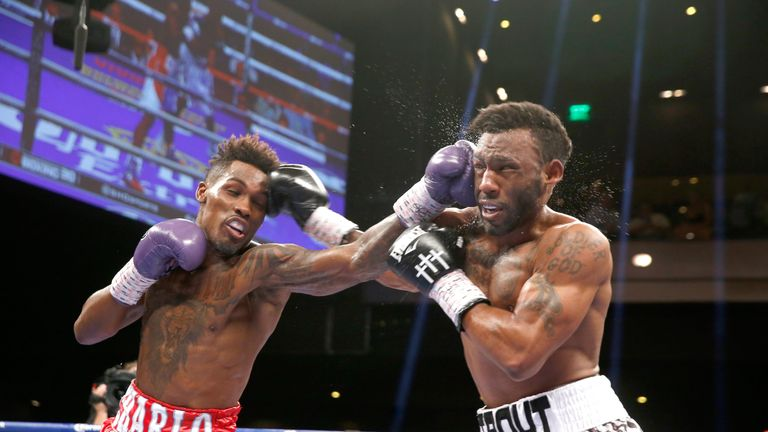 Jermall Charlo (L) beats Austin Trout to the punch in Vegas