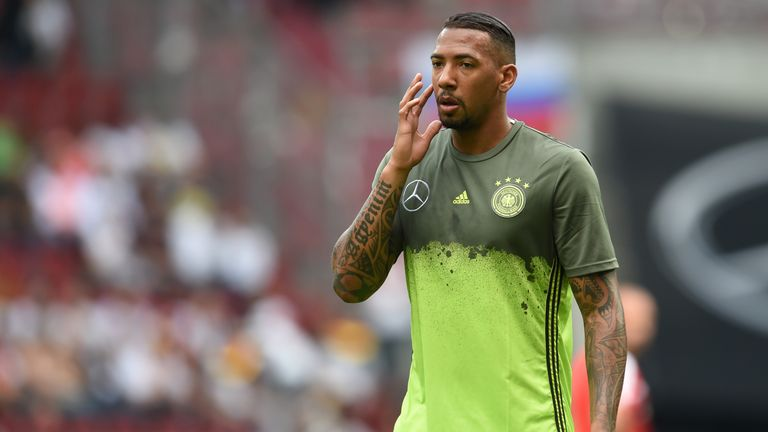 Germany's defender Jerome Boateng wipes his face during the friendly football match between Germany and Slovakia in Augsburg, southern Germany, on May 29,