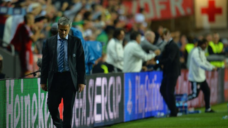 PRAGUE, CZECH REPUBLIC - AUGUST 30:  A dejected Jose Mourinho, manager of Chelsea walks along the touchline during the UEFA Super Cup between Bayern Muench