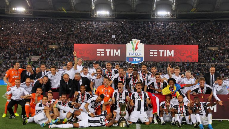 Juventus FC players celebrate with the trophy after winning the TIM Cup