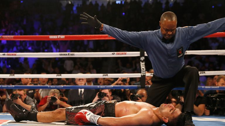 LAS VEGAS, NEVADA - MAY 07:  Amir Khan stays down after a knockout from Canelo Alvarez during the WBC middleweight title fight at T-Mobile Arena on May 7,