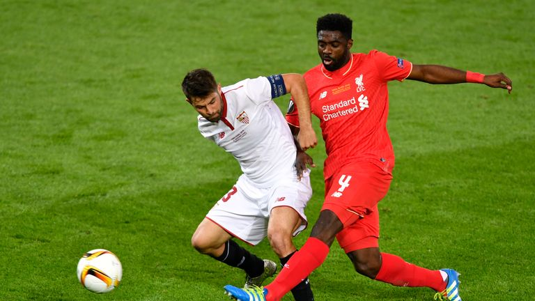 Liverpool's Ivorian defender Kolo Toure (R) vies with Sevilla's Spanish defender Coke during the UEFA Europa League final football match between Liverpool
