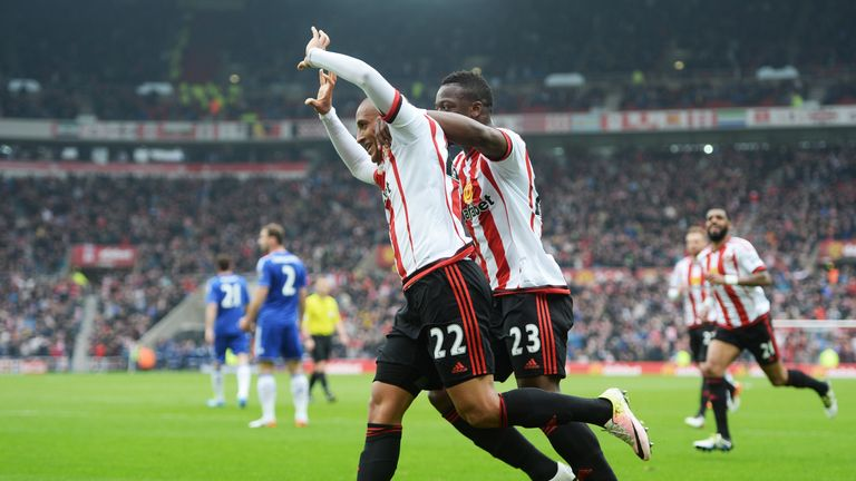 Wahbi Khazri of Sunderland celebrates scoring his team's first goal with his team mate Lamine Kone during the Premier League game against Chelsea