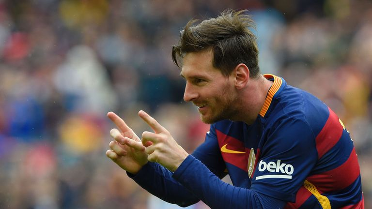 Barcelona's Argentinian forward Lionel Messi celebrates after scoring a goal during the Spanish league football match FC Barcelona vs RCD Espanyol