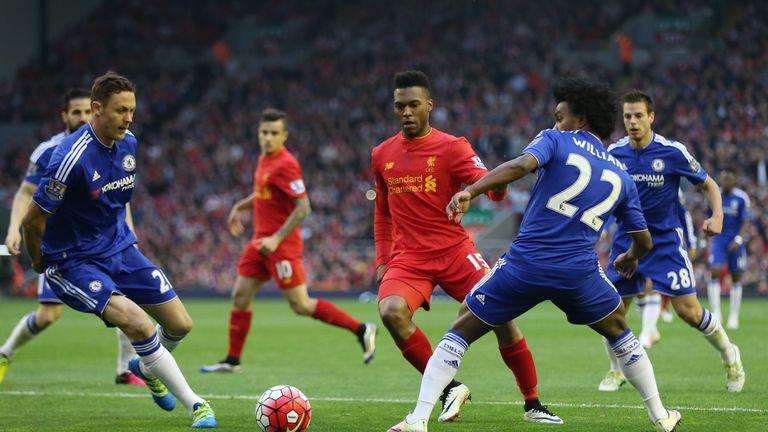 Daniel Sturridge looks to slip the ball past Willian and Nemanja Matic