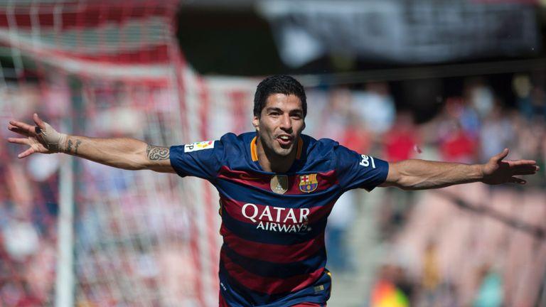Barcelona's Uruguayan forward Luis Suarez celebrates scoring against Granada