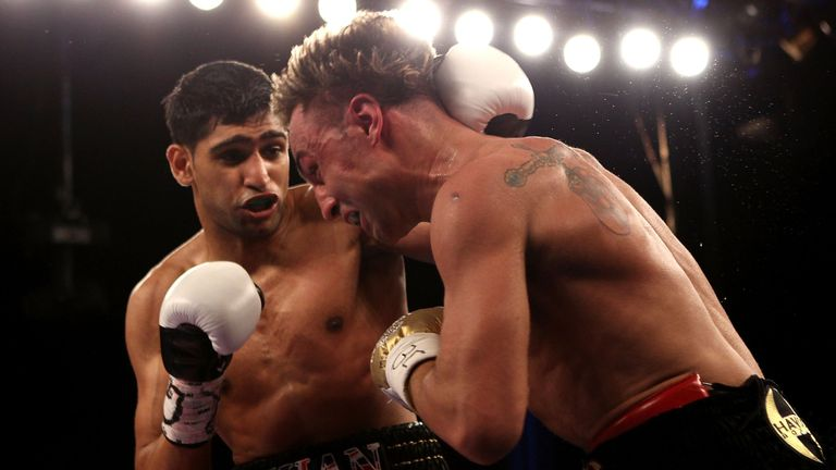 NEW YORK - MAY 15:  Amir Khan (L) of Great Britain hits Paulie Malignaggi during the WBA light welterweight title fight at Madison Square Garden on May 15,