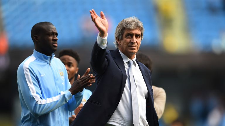 MANCHESTER, ENGLAND - MAY 08:  Manuel Pellegrini, Manager of Manchester City acknowledges the fans followin the Barclays Premier League match between Manch