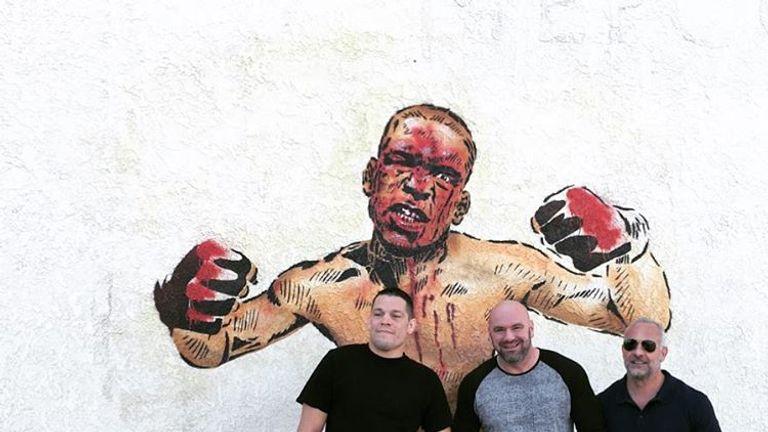 Nate Diaz (R) poses alongside Dana White (C) and Lorenzo Fertita (R) at a newly-painted mural in Stockton. Credit: Instagram: natediaz209