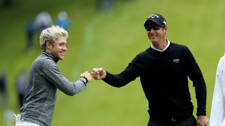 Niall Horan celebrates his birdie at the fourth with Nicolas Colsaerts
