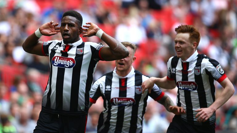 Omar Bogle (L) celebrates putting Grimsby in front at Wembley