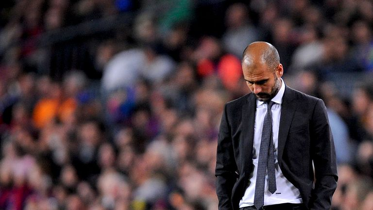 BARCELONA, SPAIN - APRIL 21:  Head coach Josep Guardiola of FC Barcelona reacts dejected during the La Liga match between FC Barcelona and Real Madrid at C