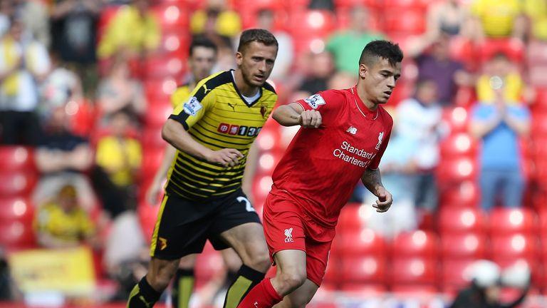 Liverpool midfielder Philippe Coutinho holds off Watford's Almen Abdi