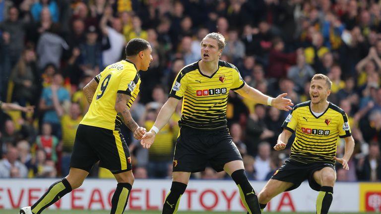 Sebastian Prodl (C) of Watford celebrates scoring his team's first goal
