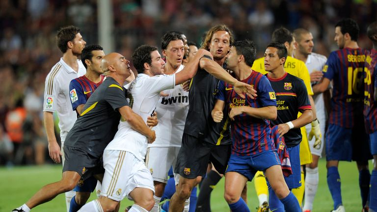 Barcelona's players argue with Real Madrid's players during the second leg of the Spanish Supercup football match FC Barcelona vs Real Madrid CF on August